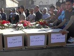 Mass grave found in freed Christian village in Syria