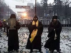 Monks from the Kiev-Caves Lavra stand between police and demonstrators in Kiev