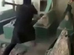 A video published in which an ISIS militant destroys the grave of Prophet Jonah