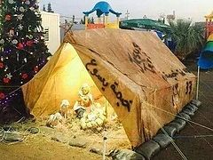 Christmas in exile: a Nativity scene set up in a camp for Iraqi refugees