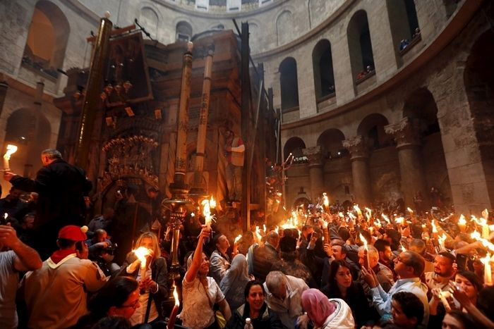 Reuters / Worshippers hold candles as they take part in the Christian Orthodox Holy Fire ceremony at the Church of the Holy Sepulchre.