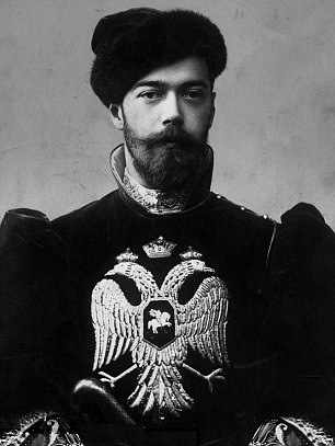 """Tsar Nicholas II, bearing the Imperial coat of arms of the double-headed eagle, representing the """"Byzantine Symphony"""" of Church and State"""
