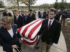 UD Jesuit High students carry caskets of the homeless