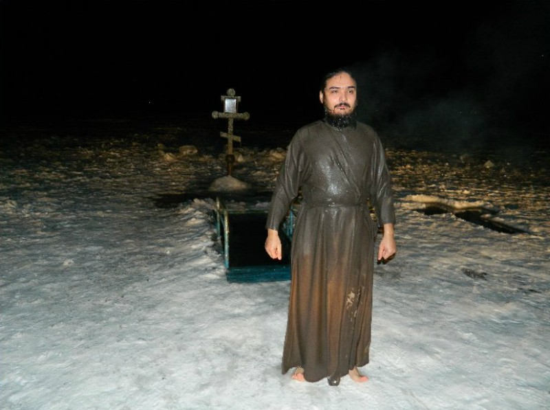 """Lake Balkhash, Kazakhstan: a priest right after immersing in an ice-hole (""""prorub"""")."""