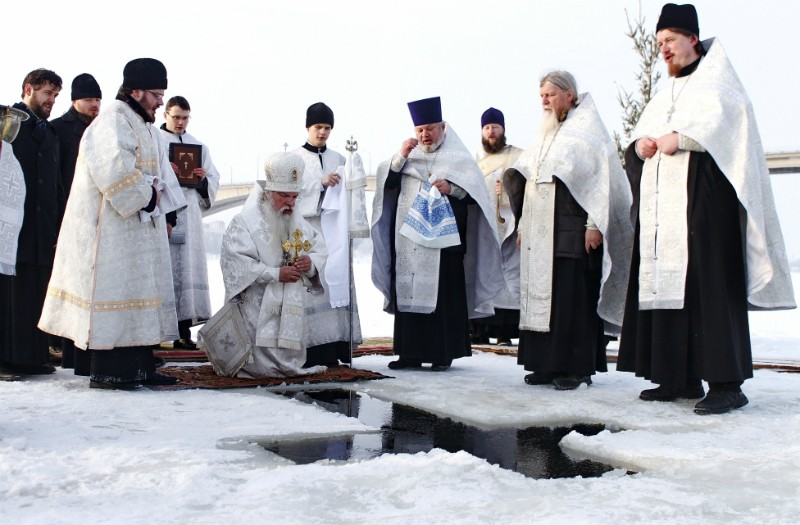 The Great Blessing of the Waters on the Volga River is being performed by late Archbishop Alexis (Frolov) of Kostroma.