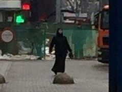 Woman in black holding severed child's head near Moscow metro station detained (GRAPHIC)