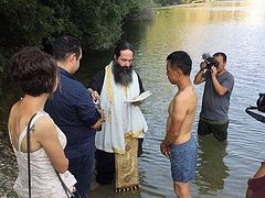 Chinese man travels thousands of miles to be baptized