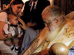 Patriarch Ilia celebrates 50th mass Baptism