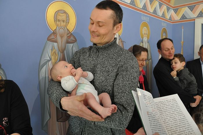 Sergei Botvinov, the godfather, with his godchild.