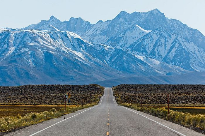 A road amidst the majestic Sierra Nevada Mountains.