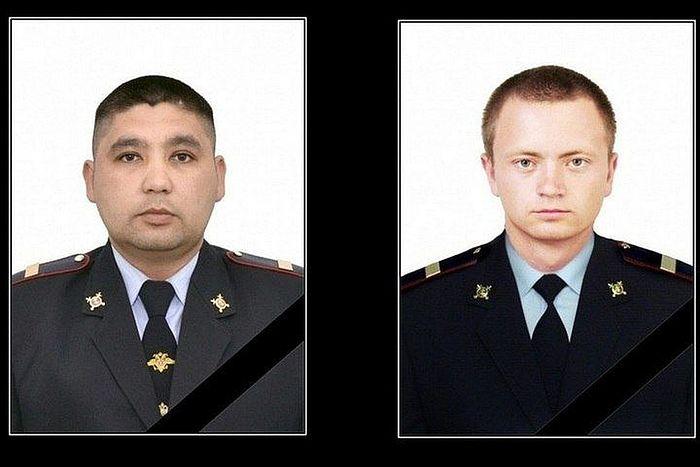 Slain police officers Kairat Rakhmetov and Vladimir Gorskov