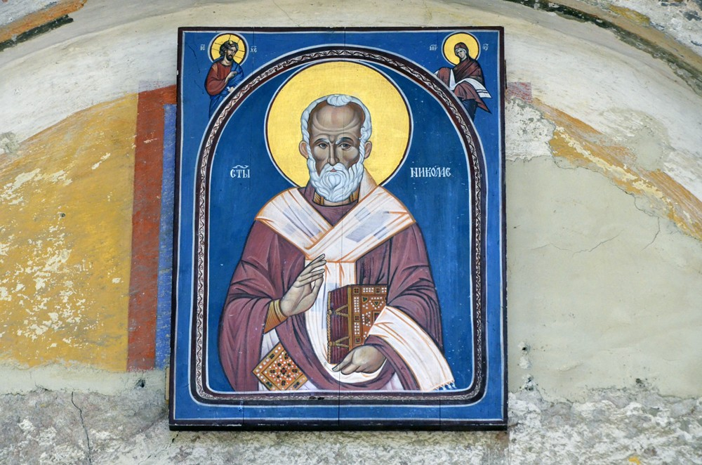 An icon of St. Nicholas the Wonderworker above the church entrance.
