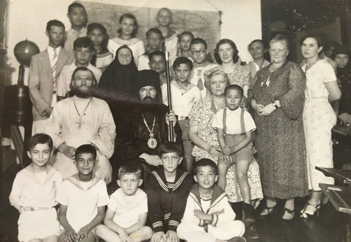 Vladyka John with parishioners. Benya is in the lower row in the center.