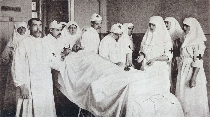 Tsarina Alexandra Feodorovna assisting with her daughters in an operating room