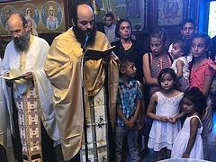 40 gypsy children baptized in Achaea