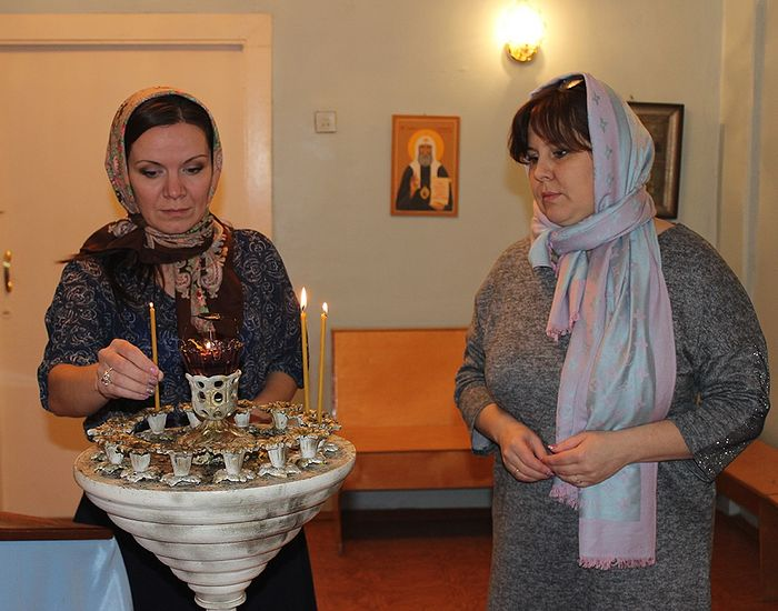 The Kochpon Psychoneurological Home's Director Olga Busheneva (to the right) and Assistant Director Maria Kropaneva attending the service at the Holy Protection Church
