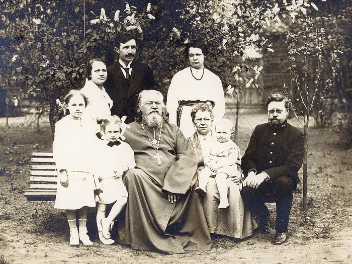 Fr. Neophyte and his family on a walk in May 1914: Hieromartyr Neophyte Lyubimov and his wife Matushka Maria (holding their grandson Konstantin) seated in center, Martyr Nikolai Varzhansky is standing with his wife Zinaida Neophyteovna on his left