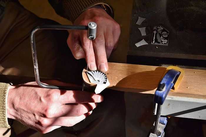 The author cutting out the mother-of-pearl Russian Imperial Eagle with a jeweler's saw