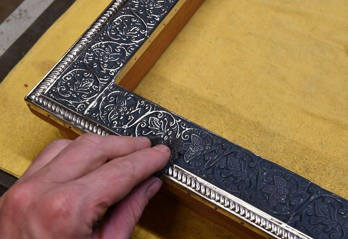 The basma background gets painted blue, and the excess rubbed off, for a jeweled enamel-like effect.