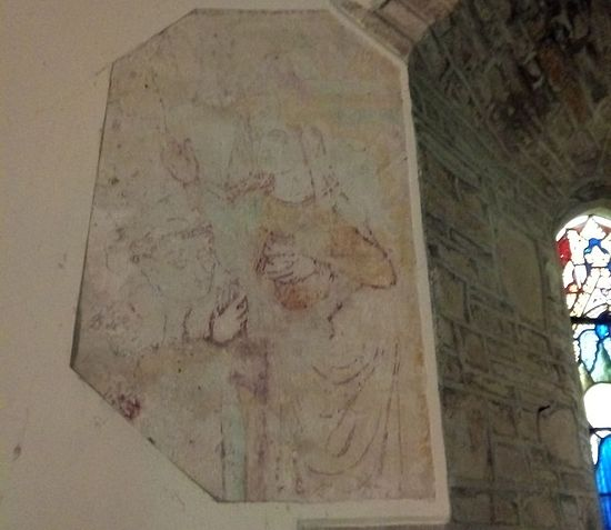 A wall painting of St. Morwenna praying over a monk inside Morwenstow church, Cornwall (photo provided by the assistant curate of Morwenstow)