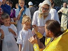 170+ baptized in river near Ekaterinburg on day of Baptism of Rus'