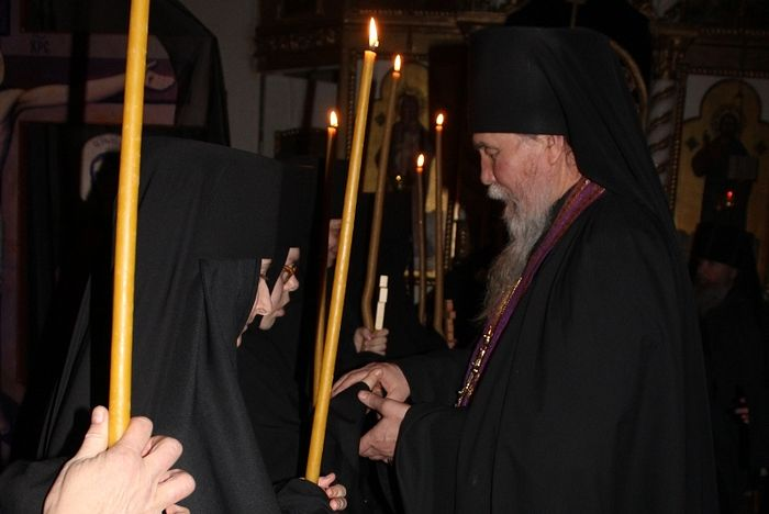 The convent's father-confessor Archimandrite Anthony (Gavrilov) congratulates the sisters on receiving the monastic tonsure.