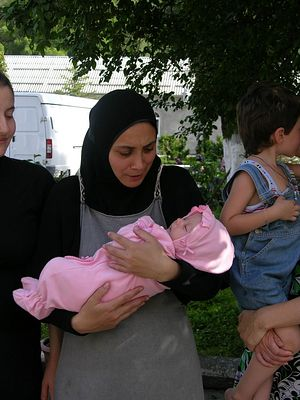 August 2008. Nun Margarita with the youngest refugee in her arms
