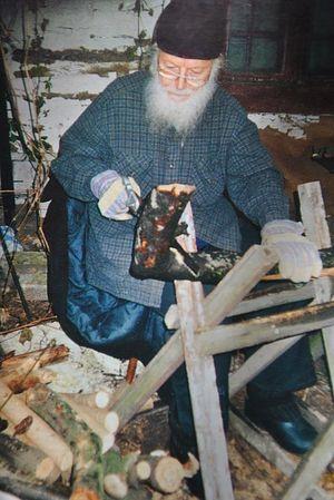 Отец Михаил за распилкой дров