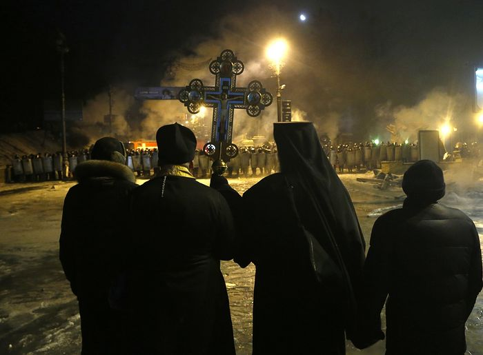 The monks of the Tithes Monastery in Kiev, standing for peace between police and Maidan revolutionaries. This monastery would later become a victim of arson perpetrated by Ukrainian nationalists.