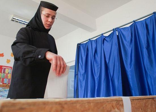 An Orthodox nun casting her ballot in Giurgiu, southern Romania. Photo: Octav Ganea/Inquam Photos