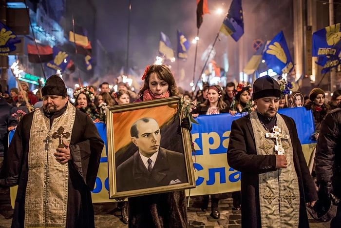 Uniates marching with Nazi war criminal portrait of Bandera