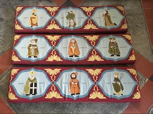 Kneelers at St. Buryan church, with images of 9 Cornish saints on one of them (provided by the rector of St. Buryan church)