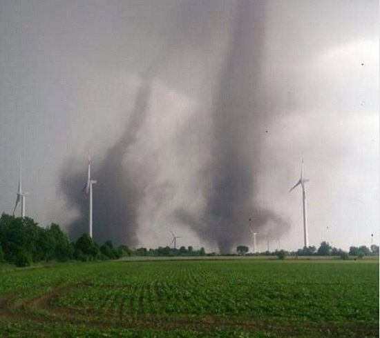 Rare twin tornadoes dance together in Schleswig-Holstein, Germany. Photo: http://strangesounds.org