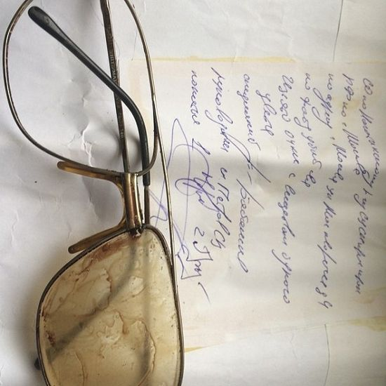 Fr. Daniel's bloodstained glasses and the envelope from SKP