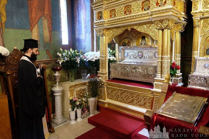 By the reliquary with the relics of St. Nectarios of Aegina