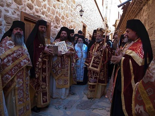 Monks pray for God's blessings on the world during their procession with Saint Catherine's relics around the katholikon on the Feastday of the Saint.