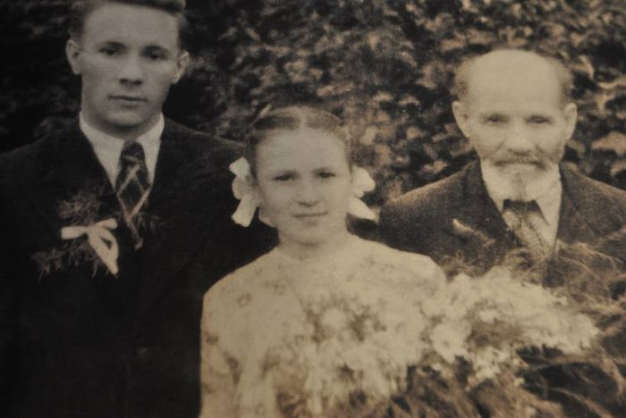 Young Olga with her father Mikhail and her brother Alexei, a future priest, 1951