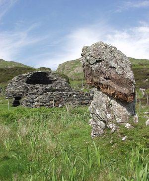 Monk's cell and standing stone, Eileach an Naoimh, Scotland. Photo: Wikimedia