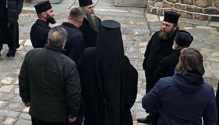 The delegation waiting outside St. Panteleimon's Monastery