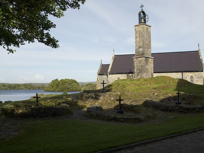A chapel, the bell-tower and penitential beds on Station Island, Lough Derg, Donegal