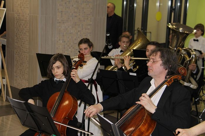 Fyodor, Ekaterina, dad and Pavel in the orchestra