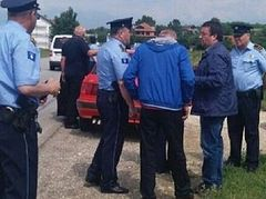 Pilgrims detained on way to church in Kosovo, police say they weren't officially notified of service
