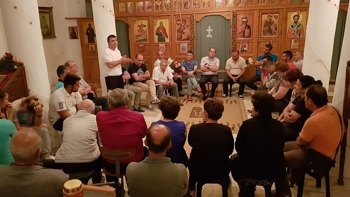 Mayor of Tepelena Termet Peci (centre) addressing supporters in the Church of St Nicolas in the village of Lekel. Photo: Termet Peci Facebook