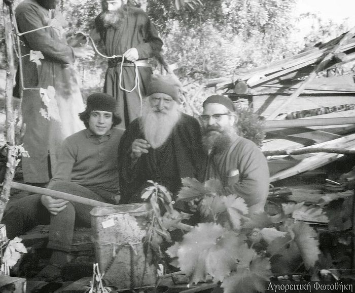 Elder Tikhon (Golenkov) in the center, with St. Paisios in the background—he is taking water from a cask to offer to the guests. 1966.