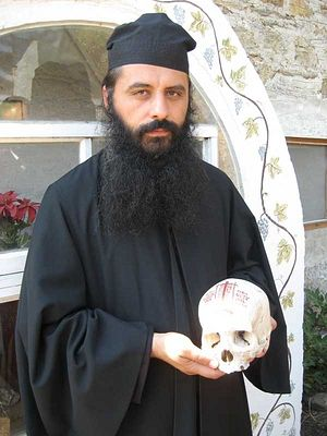 Archimandrite Porphyrios with the skull of Schema-Hieromonk Ioan (Guțu)