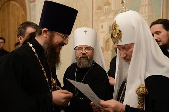 His Holiness Patriarch Kirill of Moscow and All Rus' with Archpriest Rostislav Yarema (left). Photo: patriarch.ua