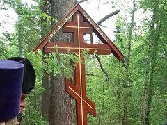 Memorial cross erected where 15 monks murdered in 1918 near Perm