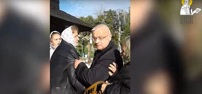 "Uniate ""Priest"" Nikolai Medinsky pushing elderly women. The ""chaplain"" previously called for ""death to the enemies""."