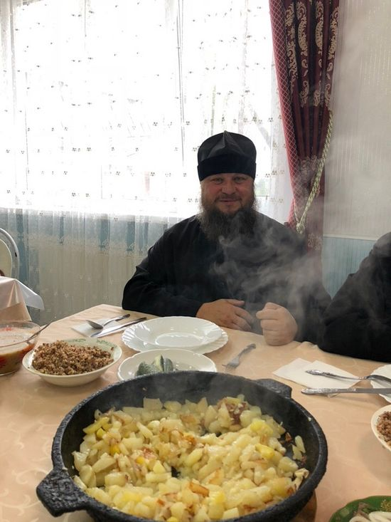 Archimandrite George with the fried potatoes he made for his guests