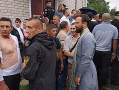 Ukrainian radicals beat priest, women in attempted church seizure